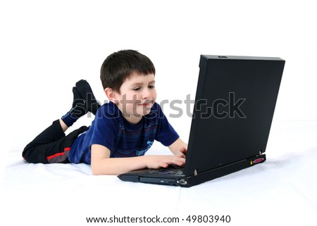 boy with a laptop on a white background - stock photo