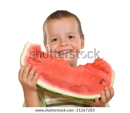 Boy with a large grin holding a watermelon slice - isolated - stock photo
