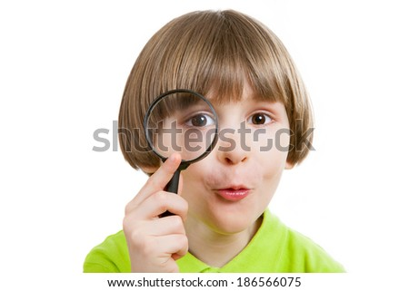 boy with a magnifying glass in his hand - stock photo