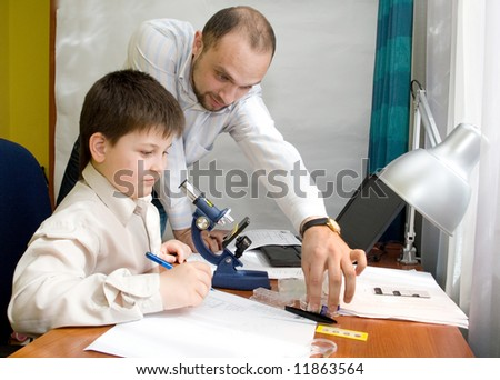 boy with a microscope in a laboratory