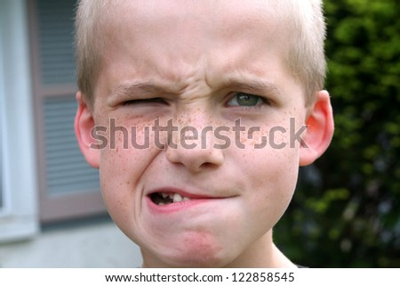 Boy With A Popeye Expression - stock photo