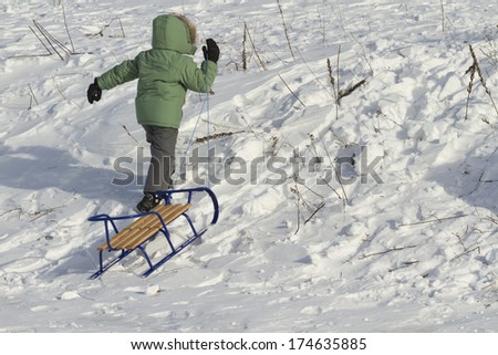 Boy with a sled.