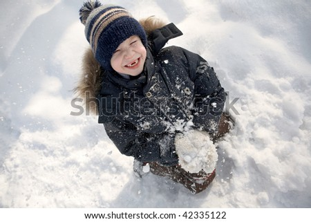 Boy with a snowball. - stock photo