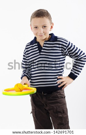 Boy with a tennis racket on white background - stock photo