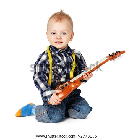 boy with a toy guitar