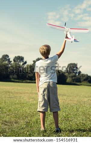 Boy with a toy plane - stock photo