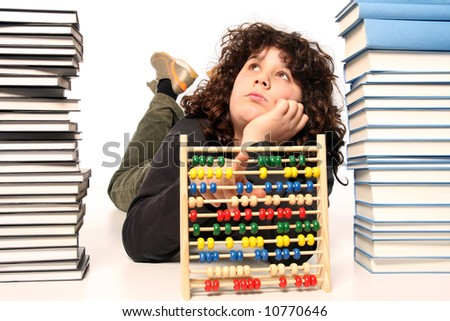boy with abacus calculator with colored beads and books - stock photo
