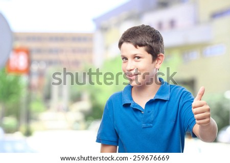 boy with all right gesture in front of the school or college - stock photo