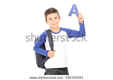 Boy with backpack holding the letter a isolated on white background - stock photo