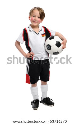 Boy with Ball under his arm - stock photo
