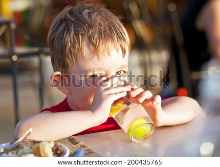 boy with beverage - stock photo