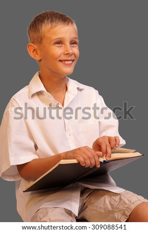 Boy with books for an education portrait - isolated on grey background