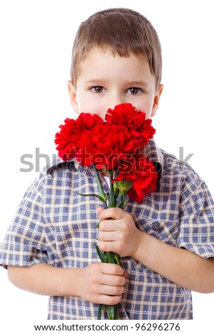 Boy with bouquet of red carnations, isolated on white - stock photo