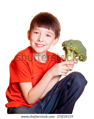 boy with broccoli isolated on white - stock photo