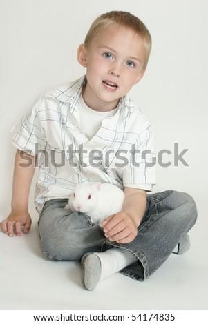 boy with bunny - stock photo