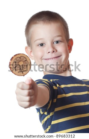 boy with candy on a stick - stock photo