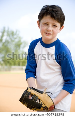 Boy with catcher's mitt and baseball - stock photo