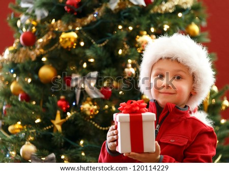 boy with Christmas gift - stock photo