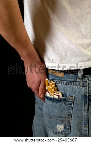 Boy with cigarette pack - stock photo
