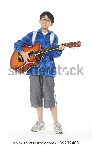 boy with classical guitar. Isolated posing on white