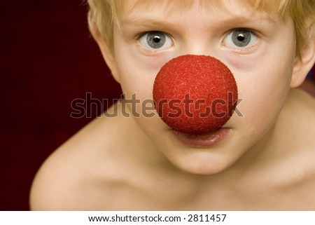 boy with clown nose - stock photo