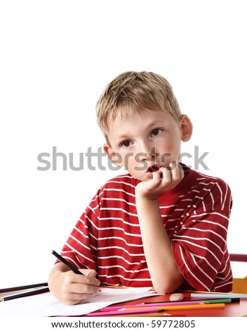 Boy with colored pencils - stock photo