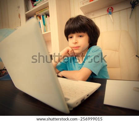 boy with computer in the interior, distance learning. instagram image retro style - stock photo