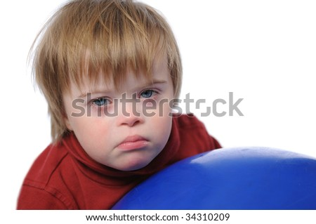 Boy with down syndrome playing with a ball isolated on a white background