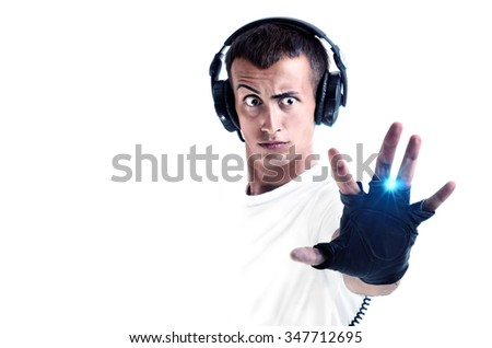 Boy with earphones and listening music isolated on white background - stock photo