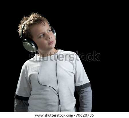 boy with earphones isolated on black