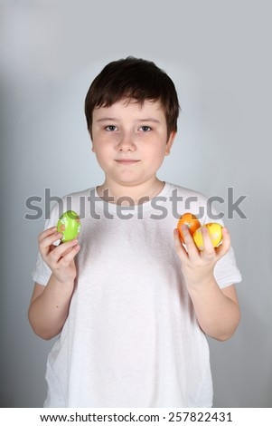 Boy with Easter eggs on a light background - stock photo