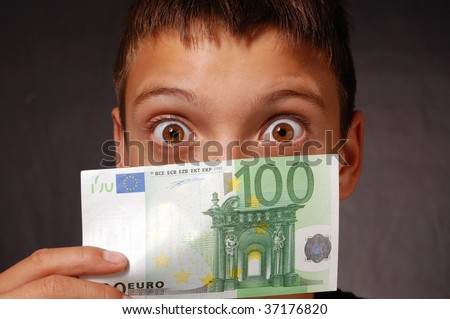 Boy with 100 euro banknote - stock photo