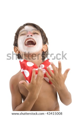 Boy with face painted and a clown tie . - stock photo