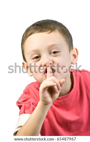 boy with finger near mouth - stock photo