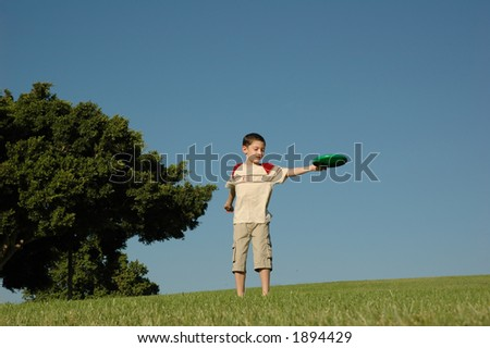 Boy with frisbee - stock photo