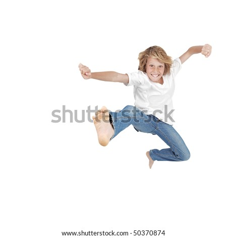 Boy with funny happy jump. (SLIGHT MOTION BLUR DUE TO STRENGTH OF JUMP) - stock photo