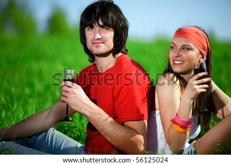 Boy with girl and with wineglasses - stock photo