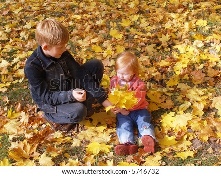 boy with girl in autumn park