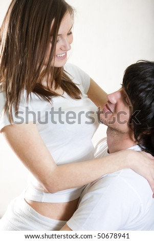 Boy with girl in white t-shirt with smile
