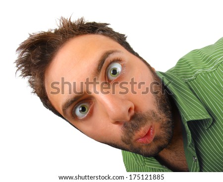 Boy with green shirt with surprised expression WOW. - stock photo