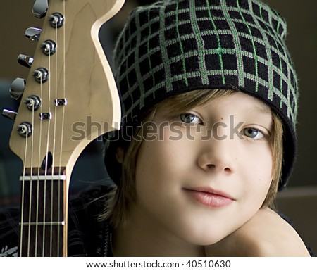 Boy with Guitar - stock photo