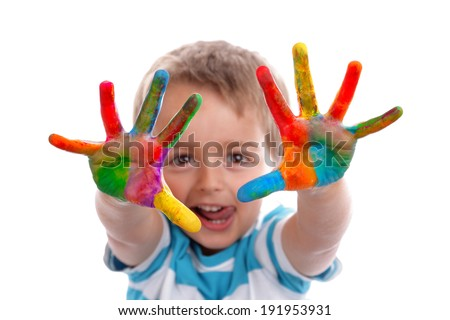 Boy with hands painted in colorful paints ready to make hand prints - stock photo