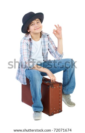 Boy with hat and suitcase, isolated over white - stock photo