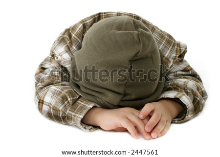 Boy with head down - stock photo