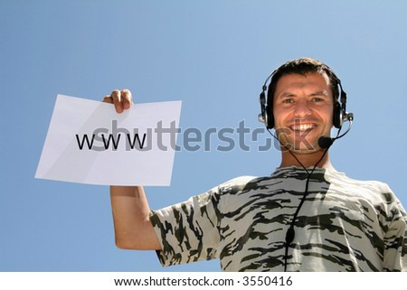 boy with headphones and board with WWW - stock photo