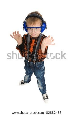 Boy with headphones and glasses listening to music.