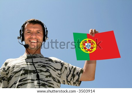 boy with headphones and Portugal Flag - stock photo