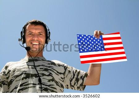 boy with headphones and USA Flag - stock photo