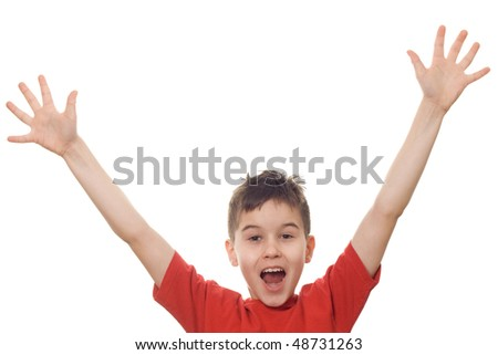 Boy with his arms in the air letting out a victory yell