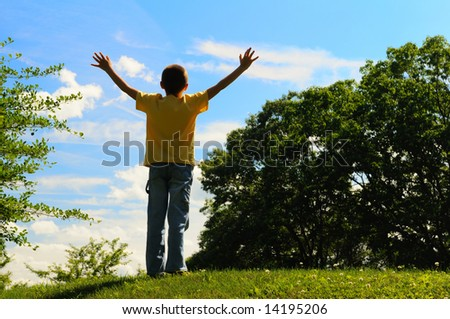 Boy with his arms wide open - stock photo